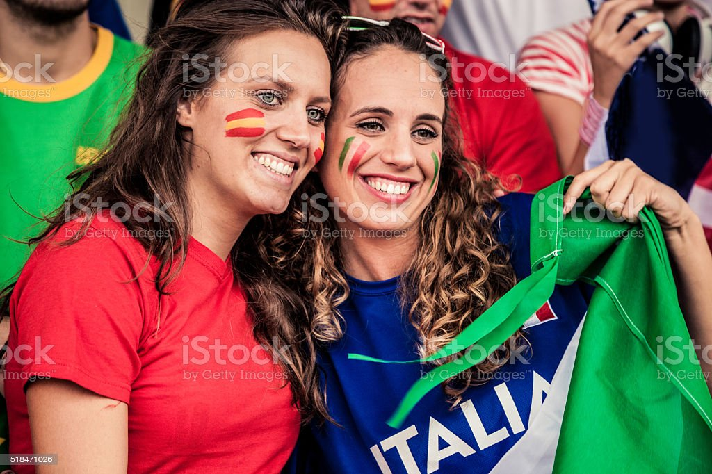 Woman supporters of different teams at the stadium stock photo