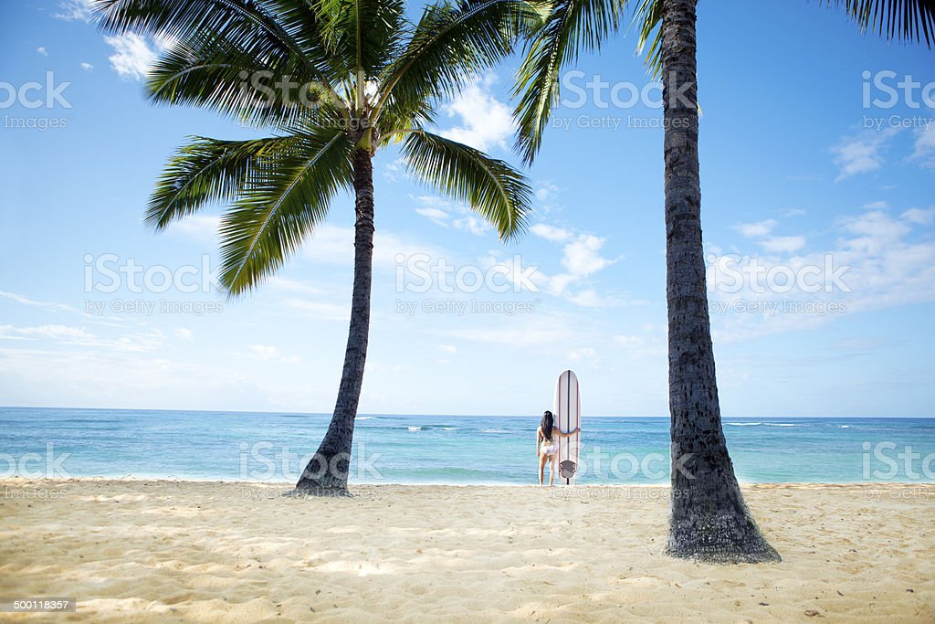 Woman Surfer on Tropical Paradise Beach royalty-free stock photo