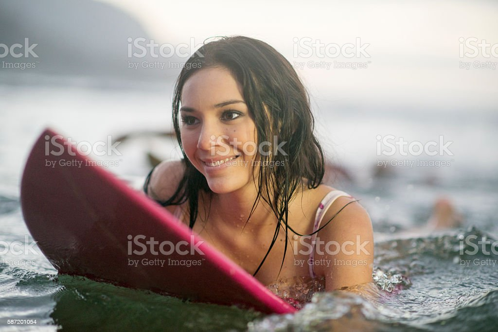Woman Surfing on Vacation stock photo