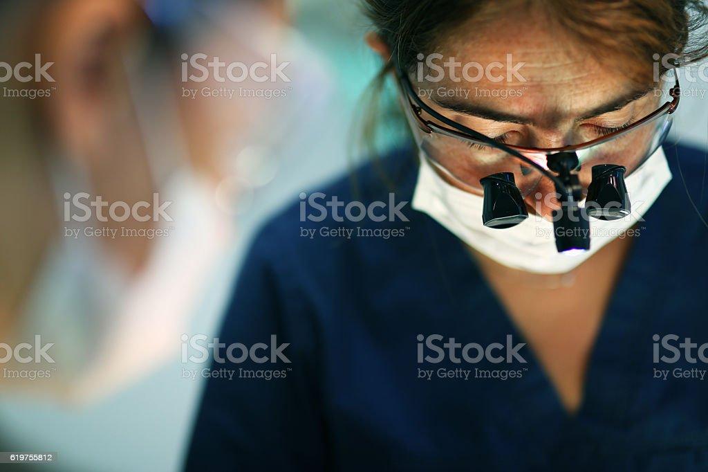 Woman surgeon dentist stock photo