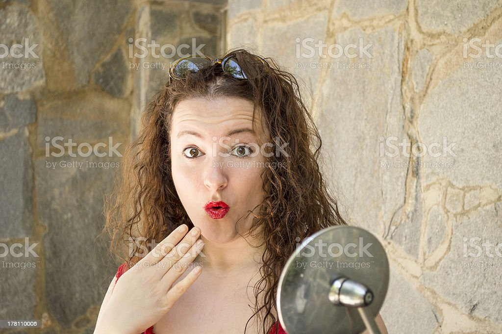 woman surprised with hand in her mouth royalty-free stock photo