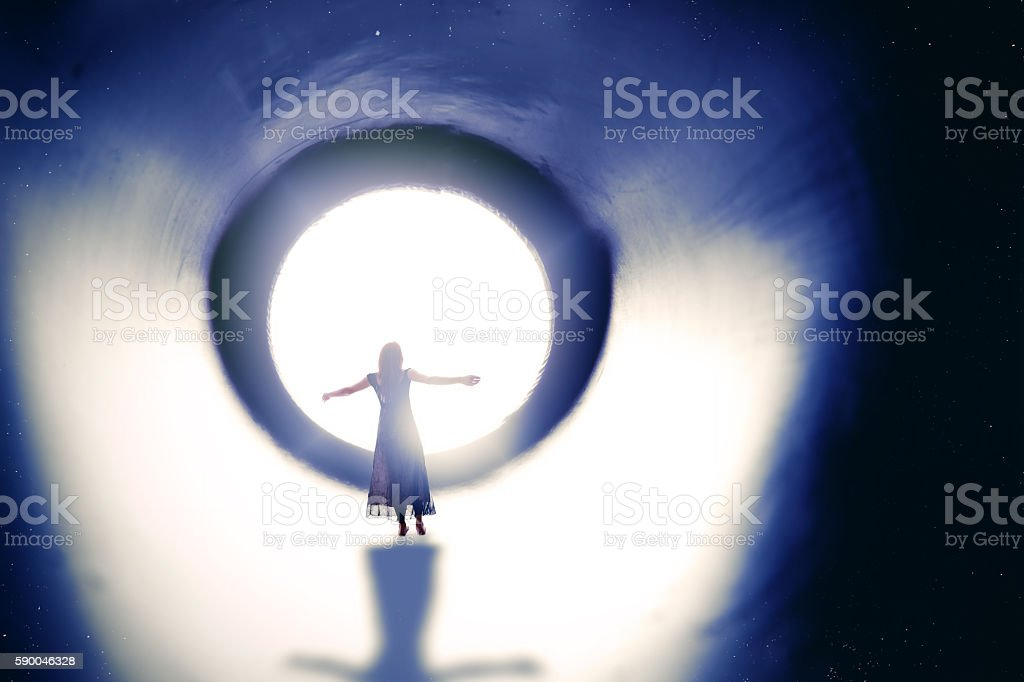 Woman Surrendering To The Light stock photo