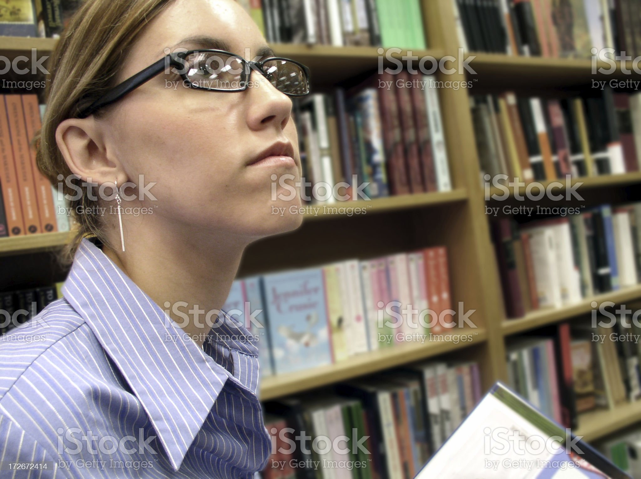 Woman surrounded by books royalty-free stock photo