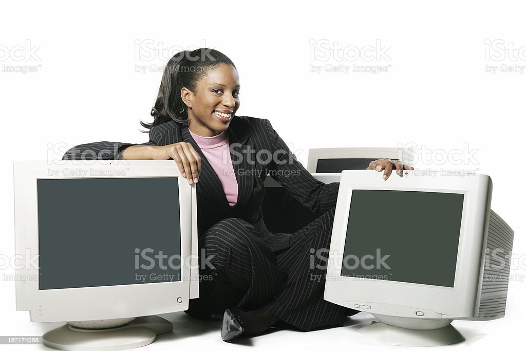 Woman surrounded by computers I royalty-free stock photo