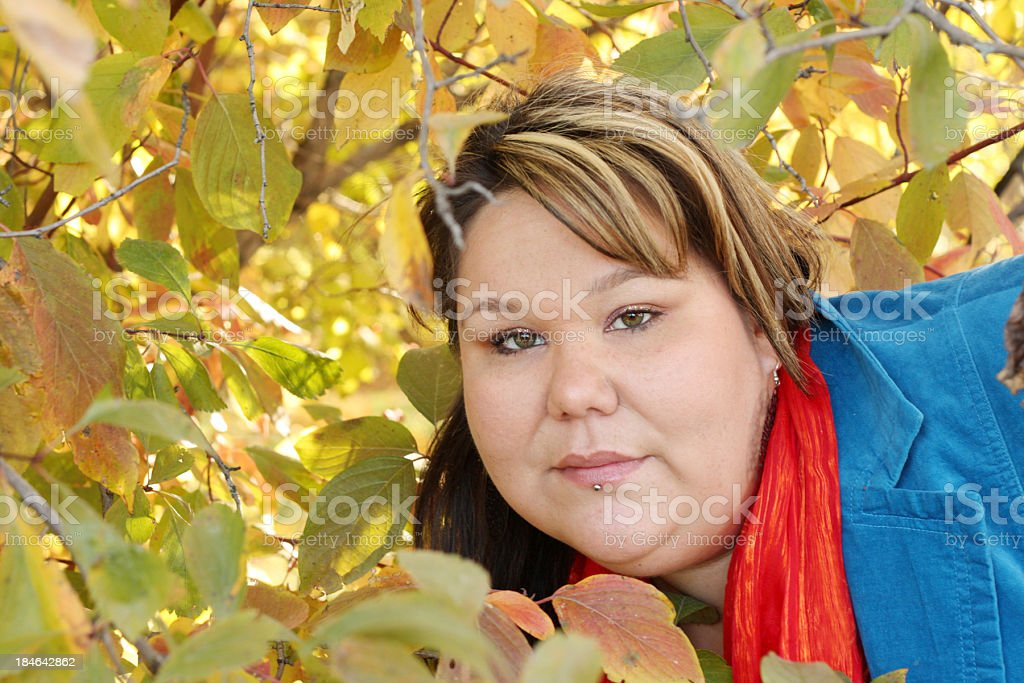 Woman Surrounded By Fall Foliage stock photo