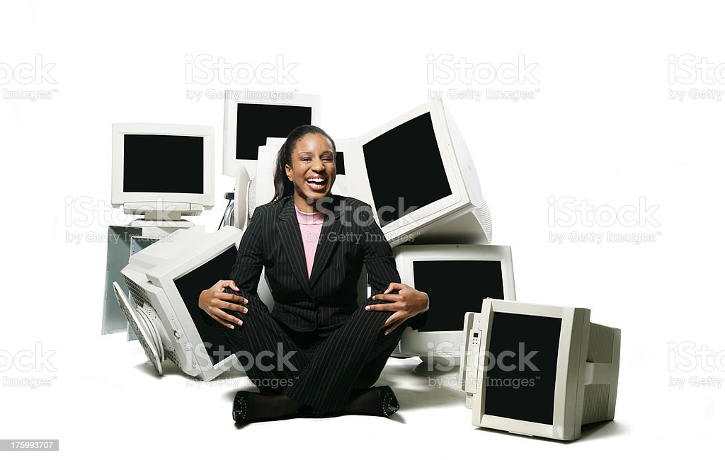 Woman surrounded by screens royalty-free stock photo