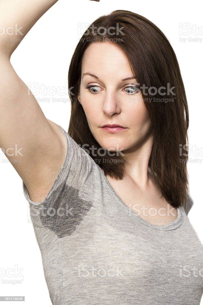 Woman sweating very badly under armpit royalty-free stock photo