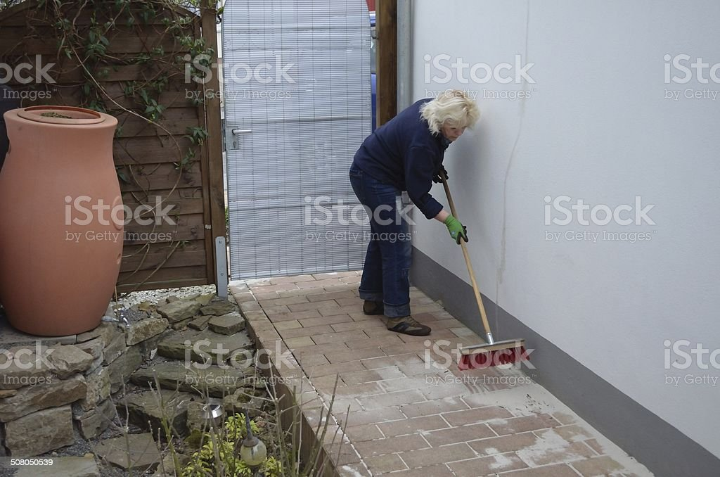 Woman swept with broom on stock photo