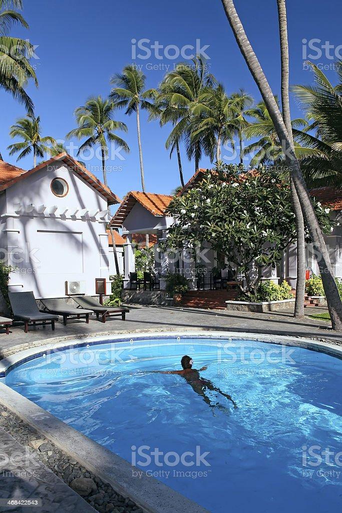 Woman  swiming in pool at tropical resort royalty-free stock photo