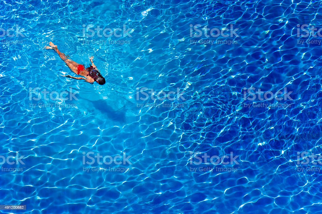 woman swimming and diving in water pool stock photo