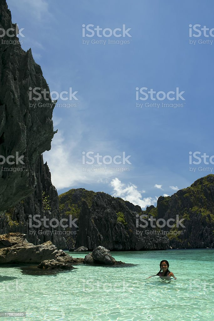 woman swimming clear water el nido royalty-free stock photo