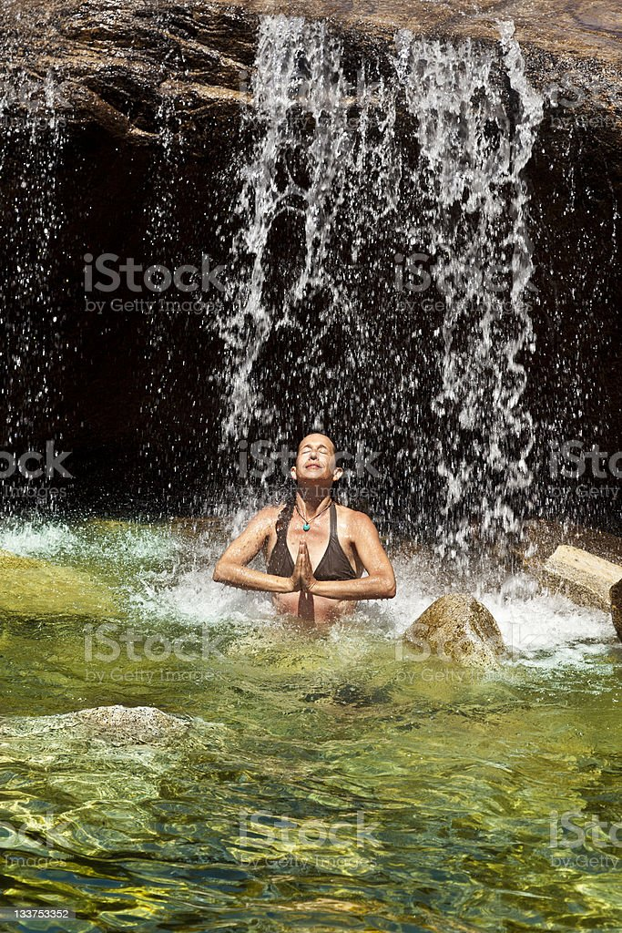 Woman swimming in a natural pool. royalty-free stock photo