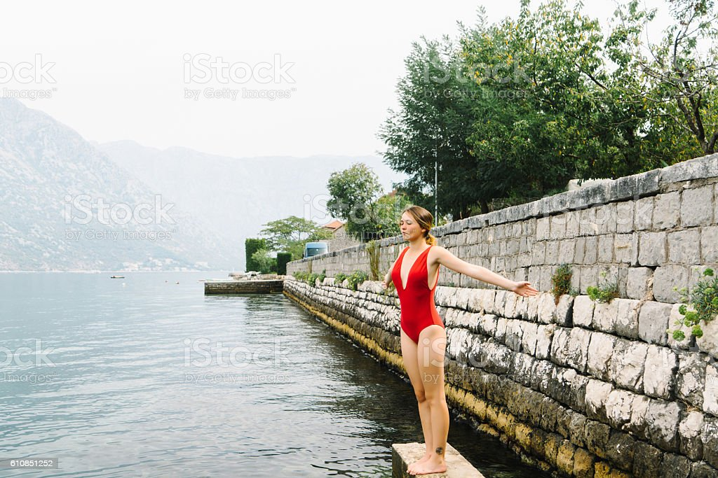 Woman swimming in Kotor Bay stock photo