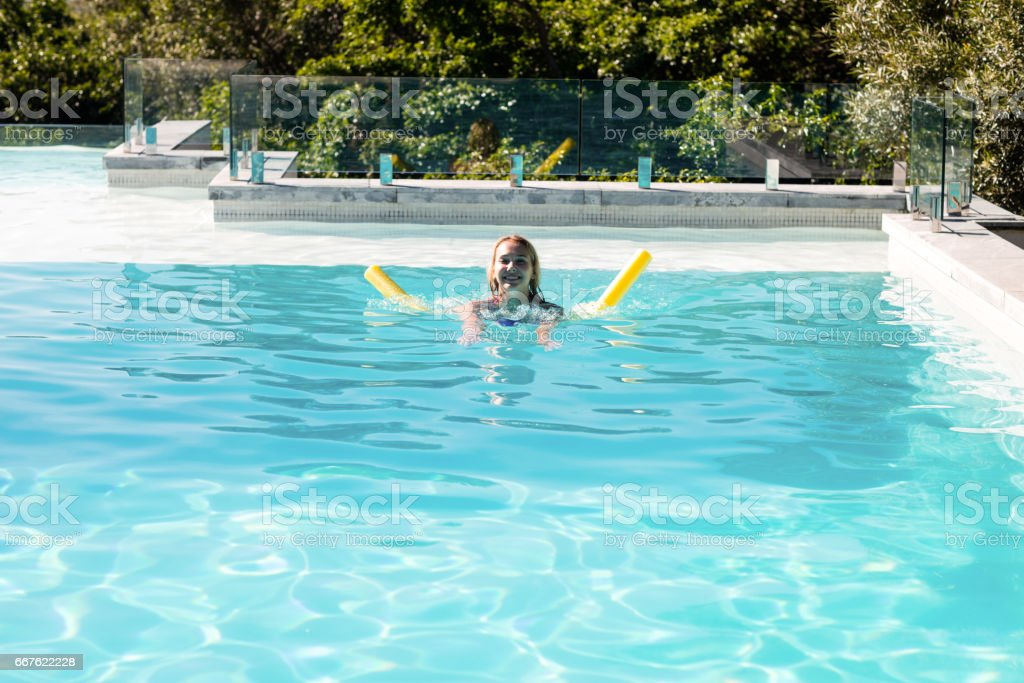 Woman swimming in swimming pool royalty-free stock photo