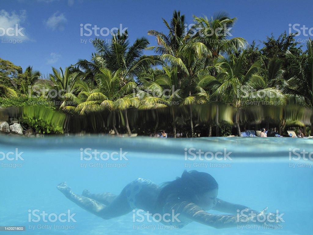 Woman swimming in tropical ocean stock photo