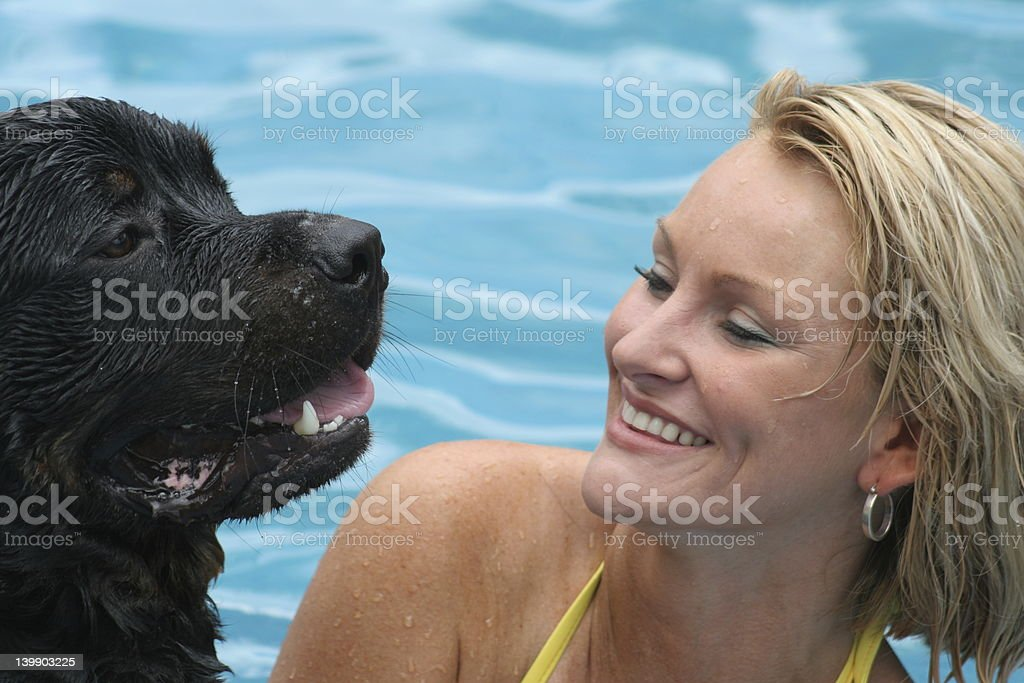 Woman swimming with dog royalty-free stock photo