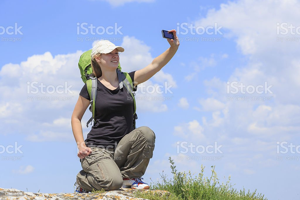 Woman take a picture on top of mountain royalty-free stock photo