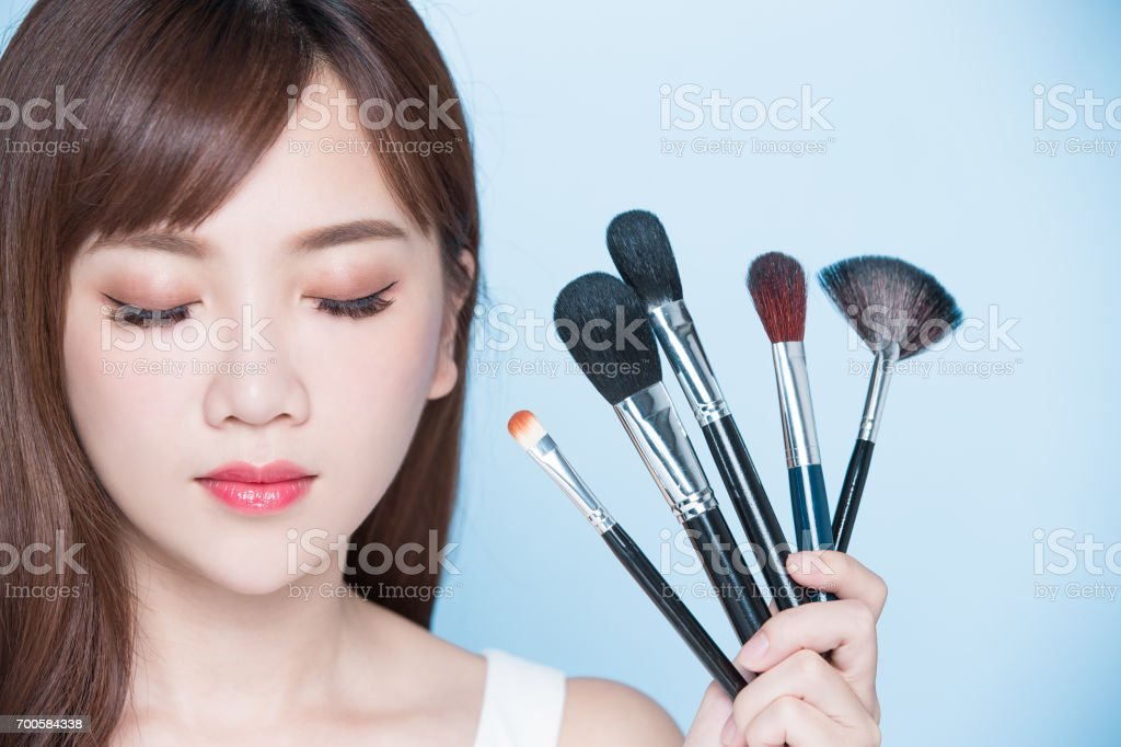 woman take makeup brush stock photo
