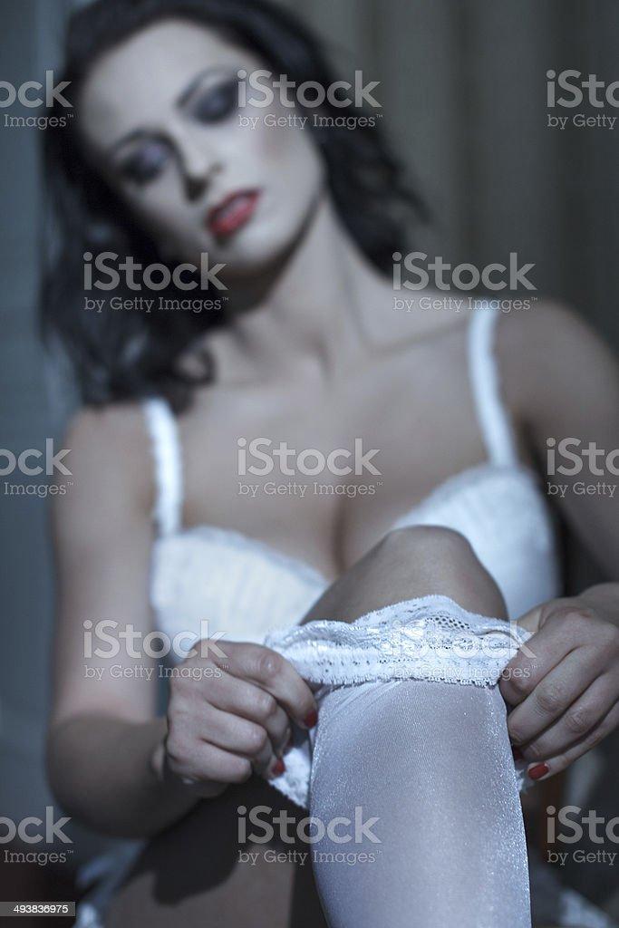 Woman take off white stockings royalty-free stock photo