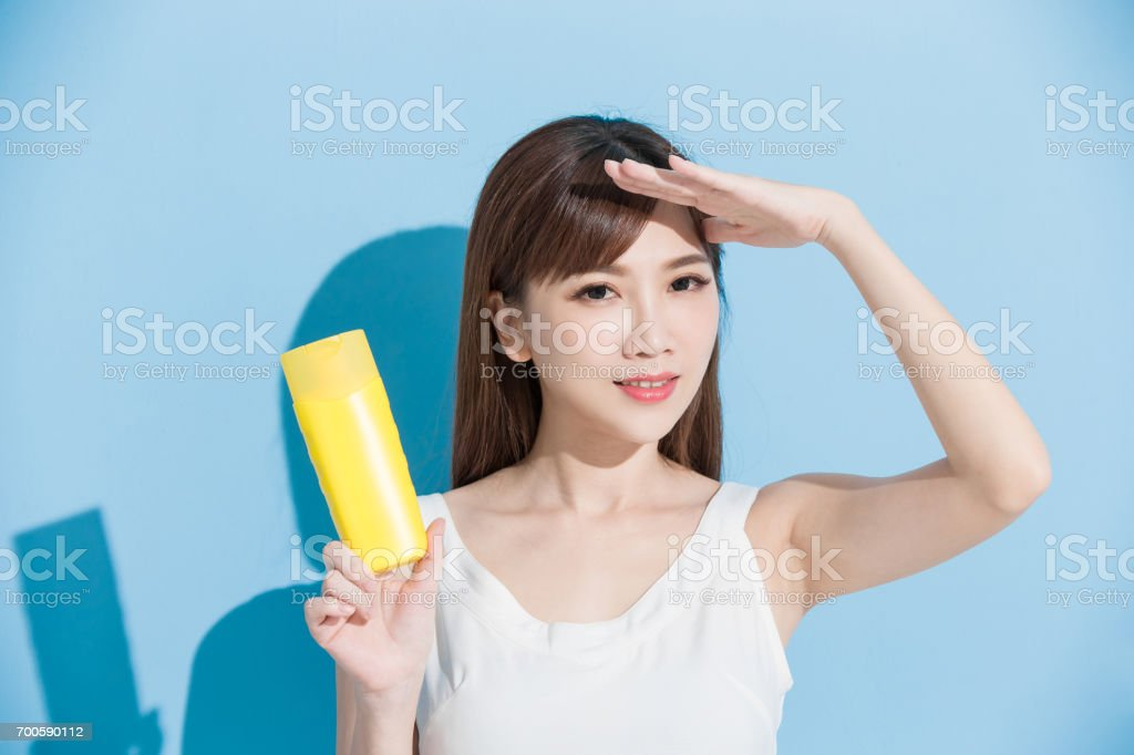 woman take sunscreen stock photo