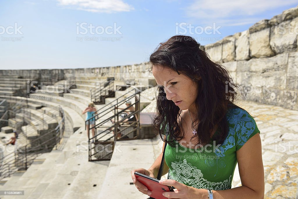 Woman takeing pictures with her smartphone stock photo