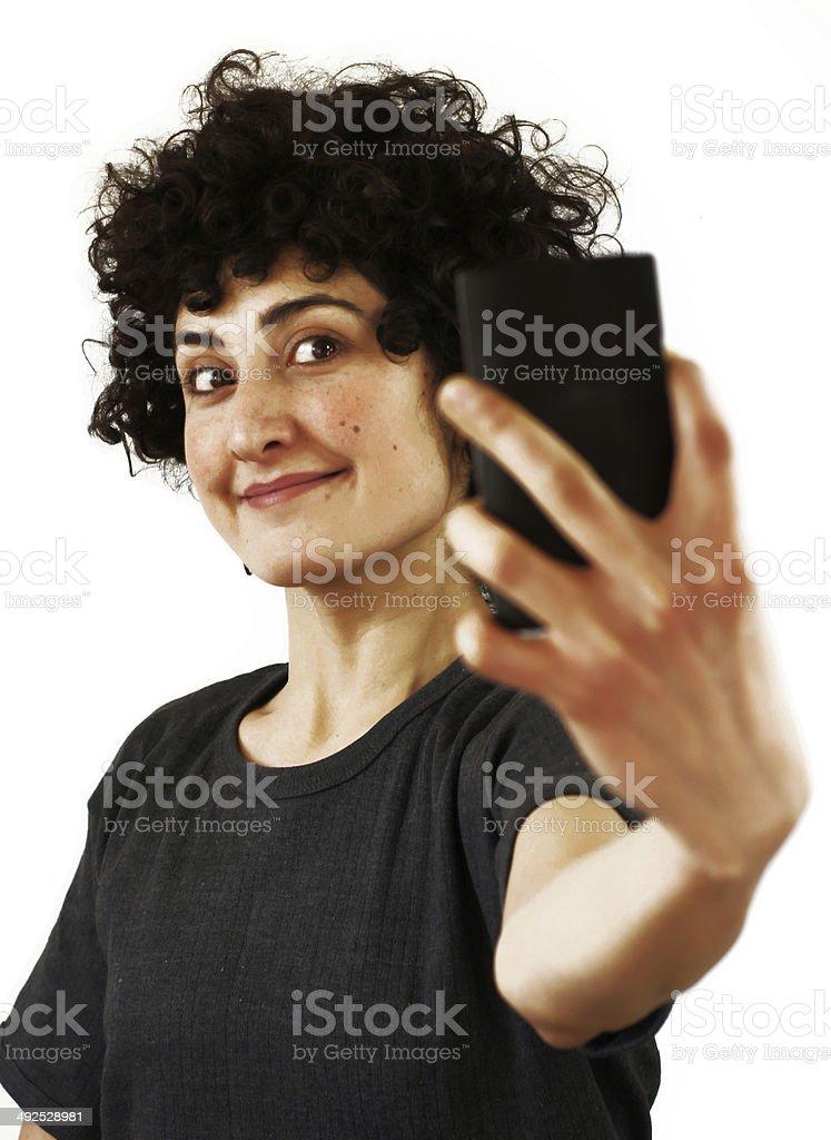 Woman takes a self portrait stock photo