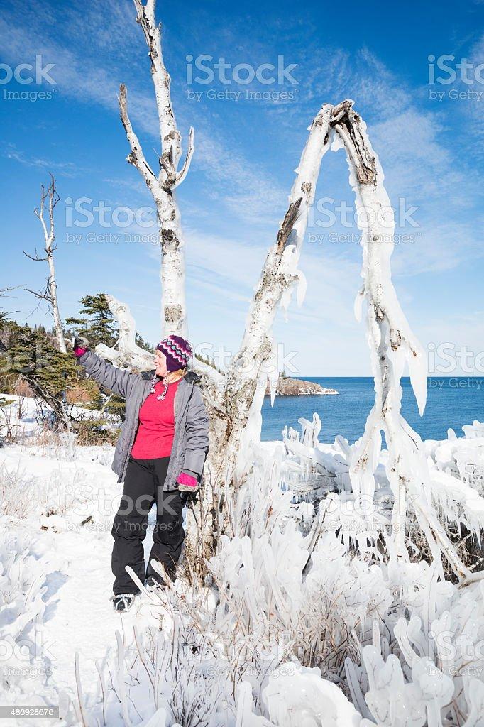 Woman takes a selfie by a frozen tree in Minnesota stock photo