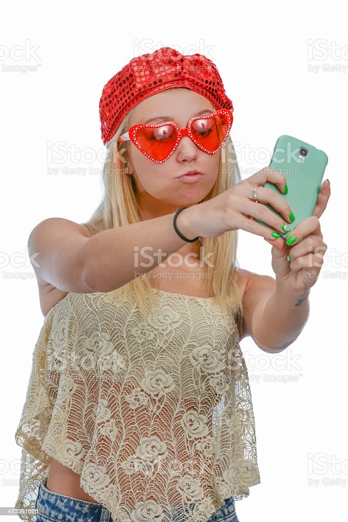 Woman takes a selfie with a cell phone. stock photo