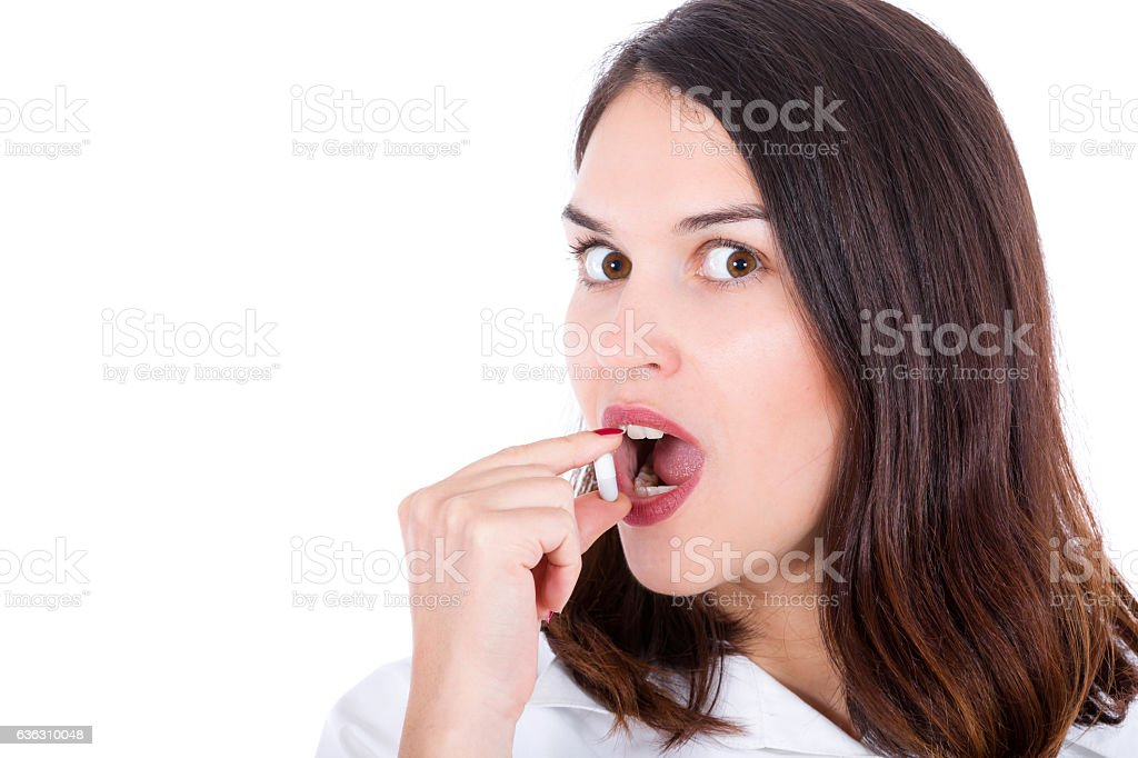 woman takes capsule stock photo