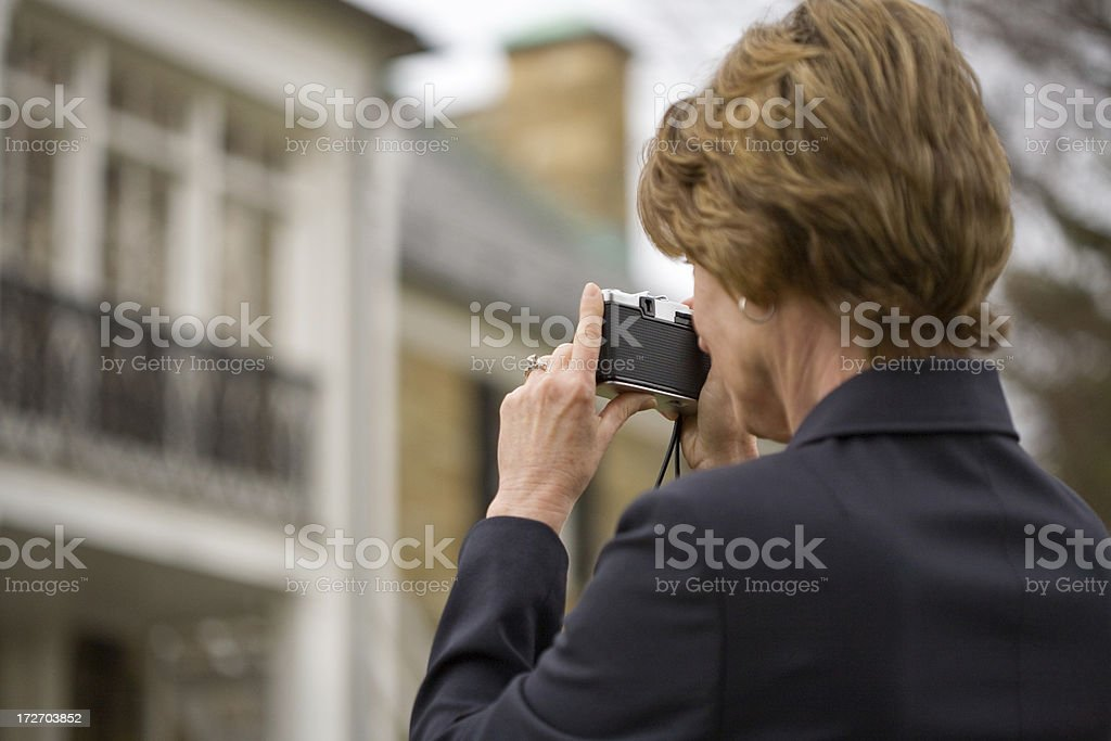 woman takes photo of a house royalty-free stock photo