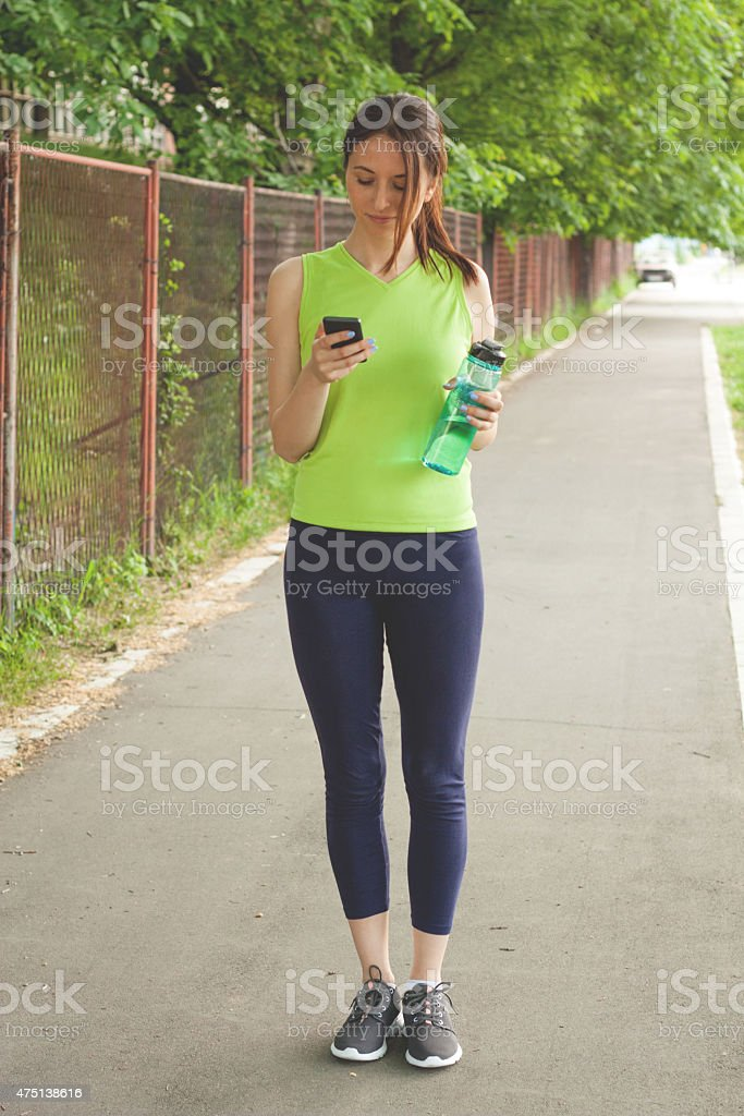 Woman Taking a Break From Running stock photo