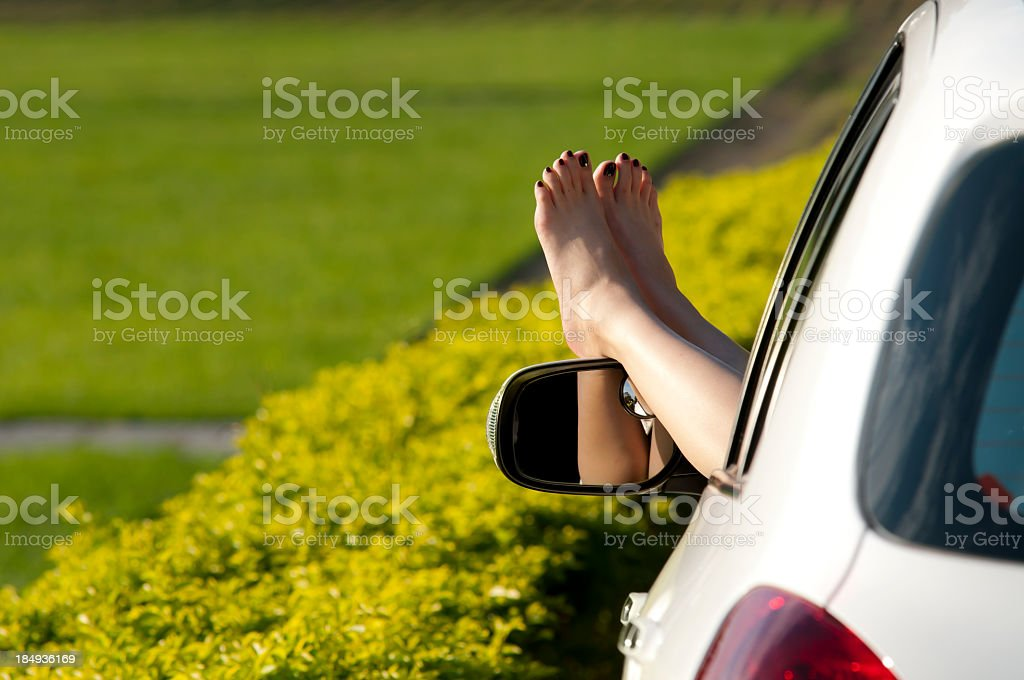 Woman taking a break in the country with feet out car window royalty-free stock photo