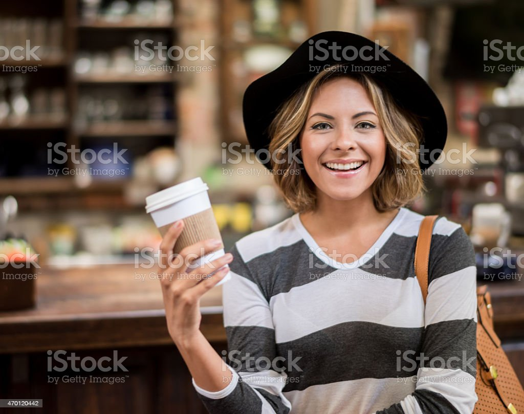 Woman taking a coffee to go stock photo