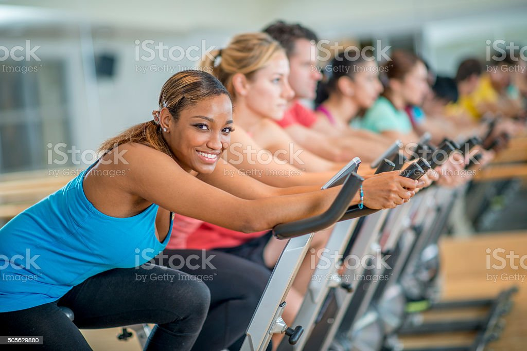 Woman Taking a Spin Class stock photo