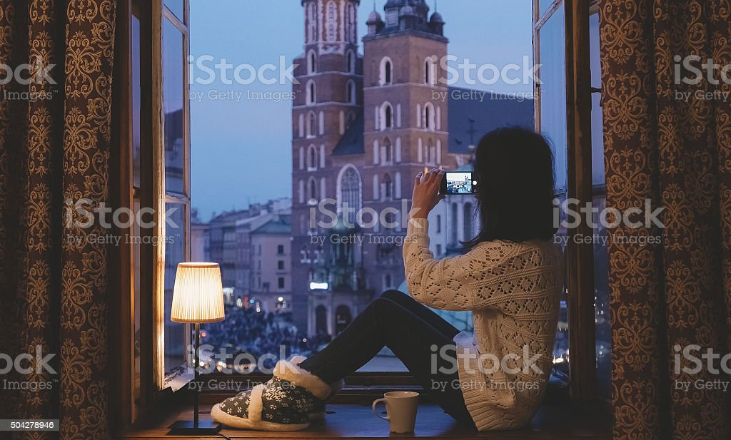 Woman taking a photo of Krakow city stock photo