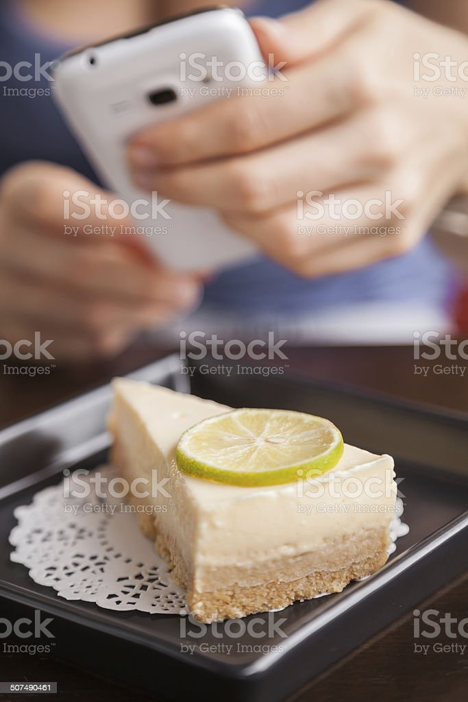 Woman Taking a Photo On Her Mobile Phone Of Food stock photo