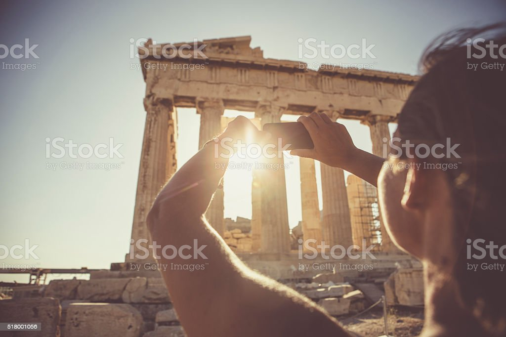 Woman taking a selfie in front of Parthenon stock photo