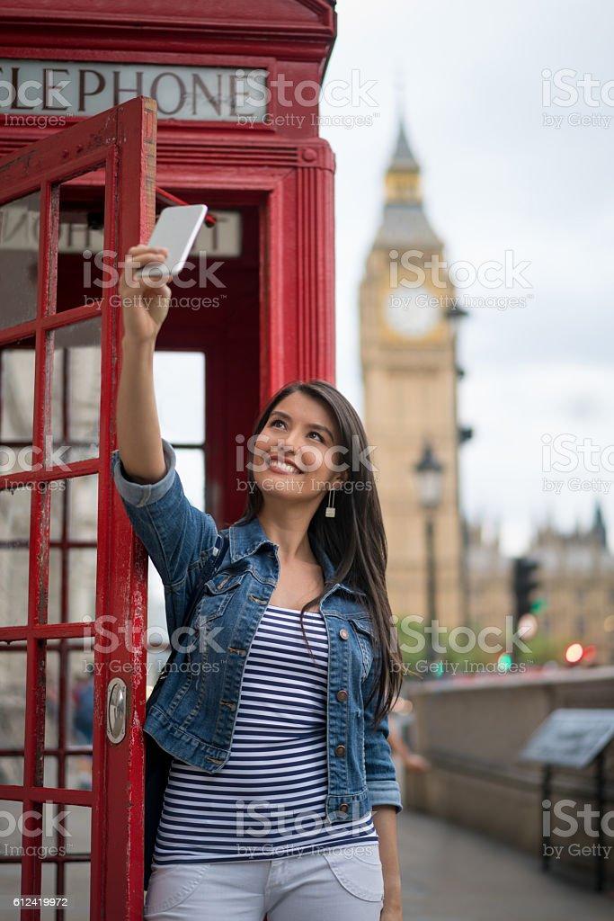Woman taking a selfie in London stock photo