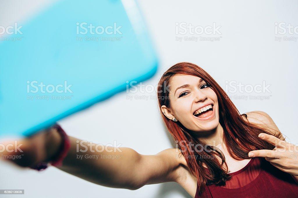 Woman taking a selfie stock photo