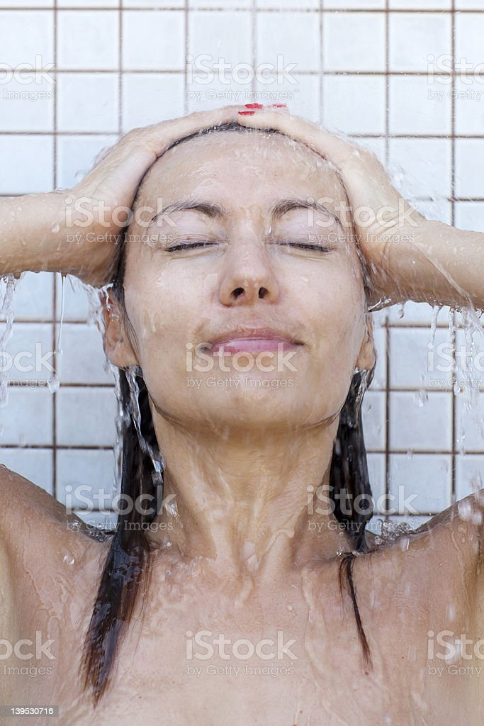 woman taking a shower royalty-free stock photo
