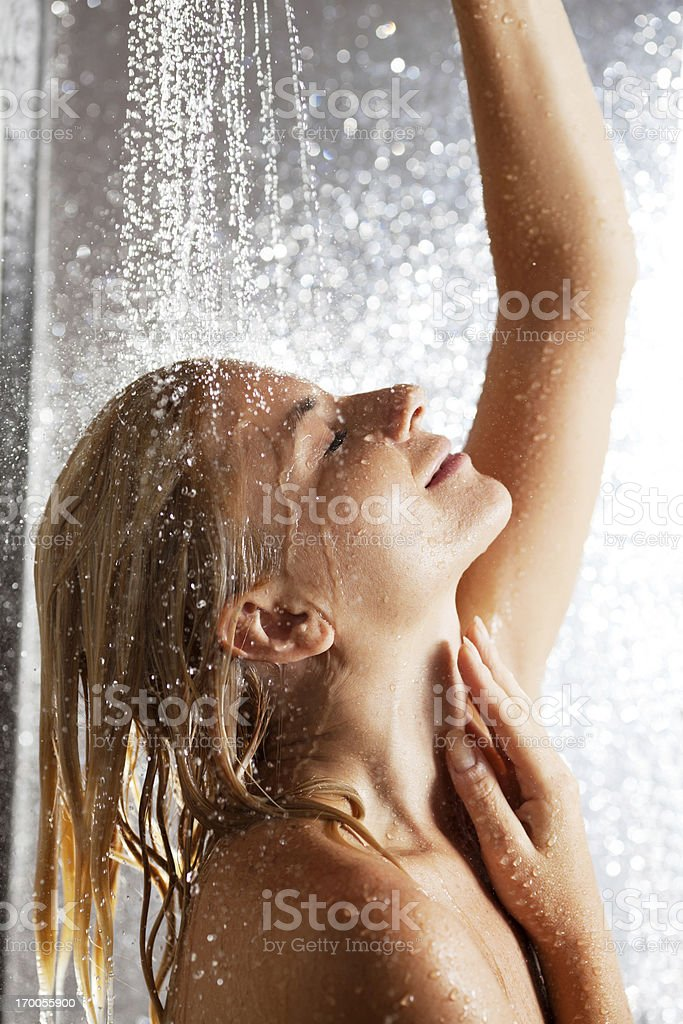 Woman taking a shower. royalty-free stock photo