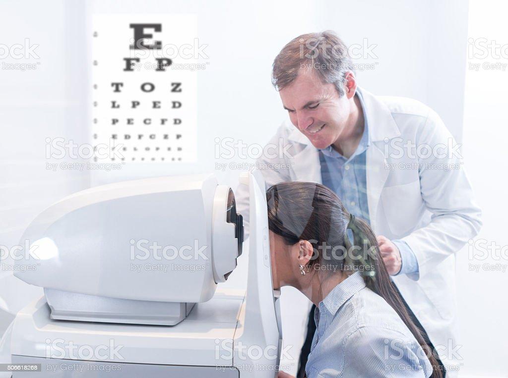 Woman taking an eye exam stock photo