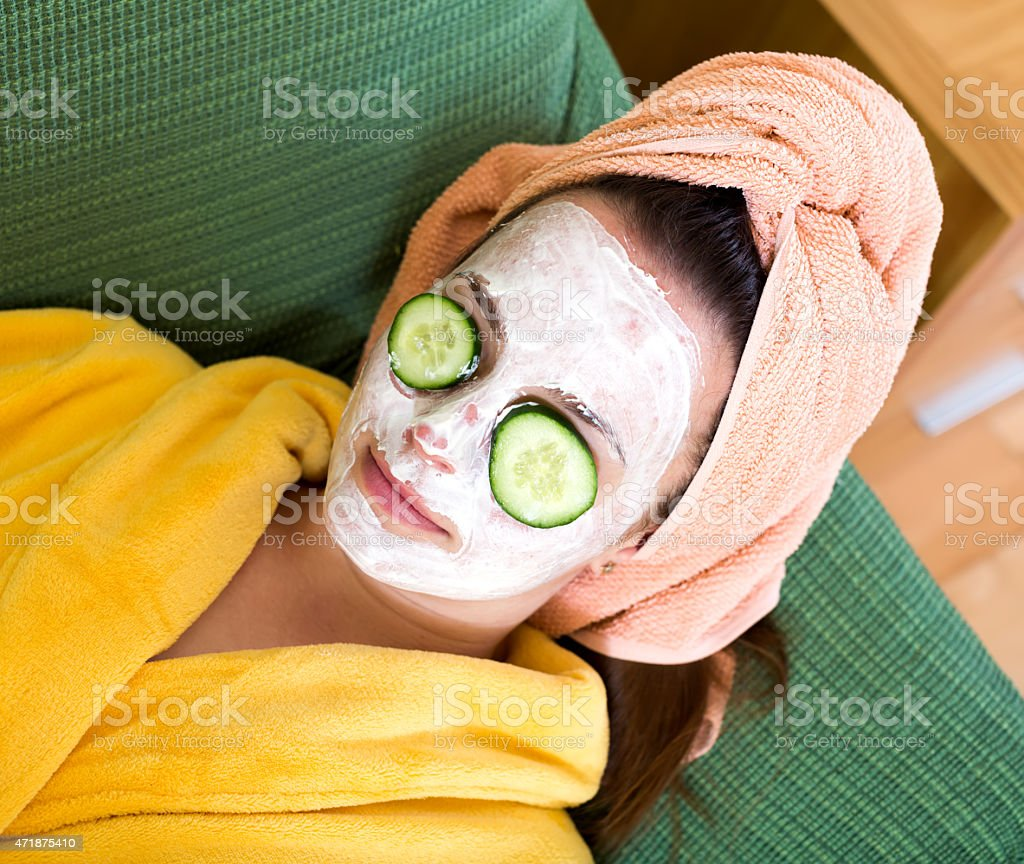 Woman taking care of her face stock photo