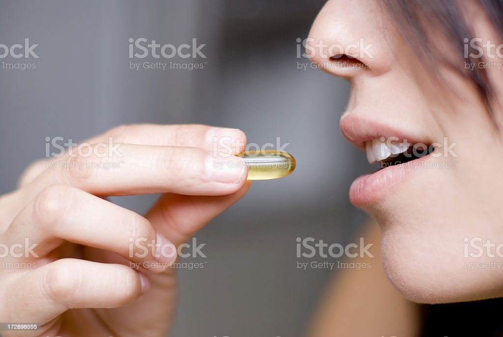 Woman taking medicine royalty-free stock photo