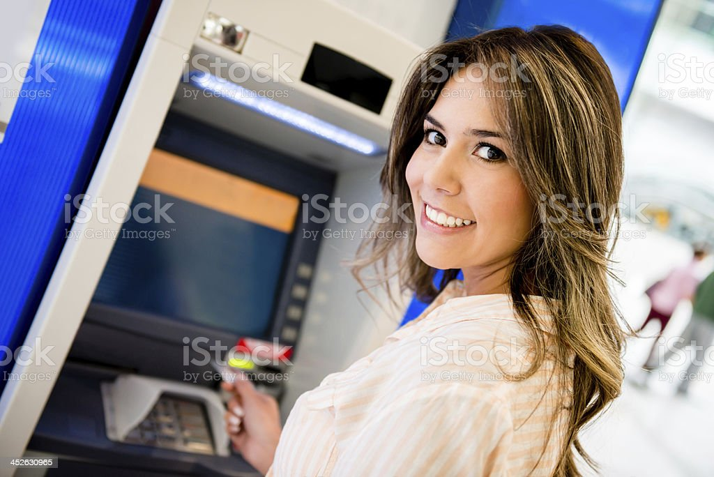 Woman taking money out royalty-free stock photo