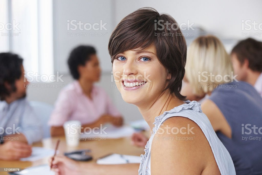 Woman taking notes in meeting royalty-free stock photo