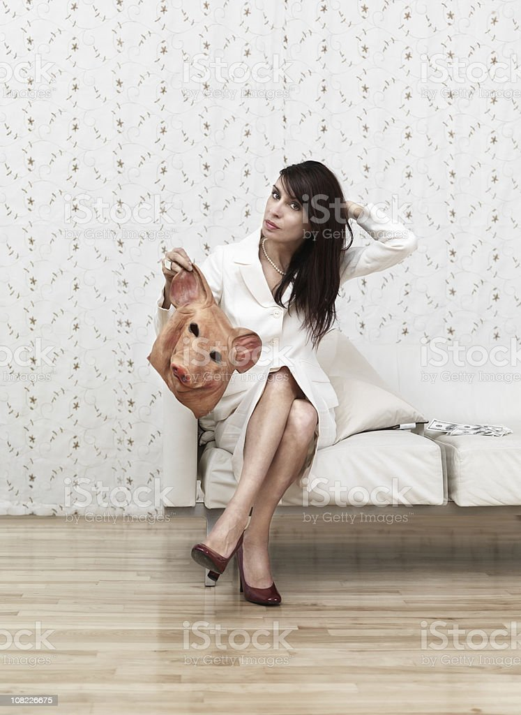 Woman taking off a mask royalty-free stock photo