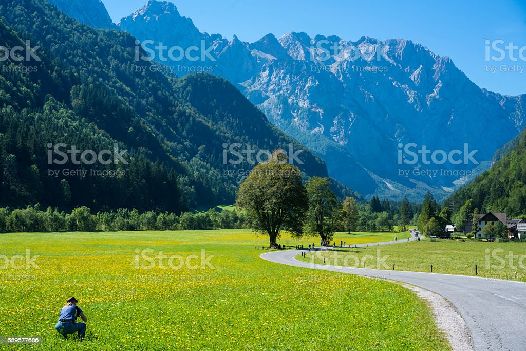 Woman taking photo of beautiful Logar Valley, Slovenia stock photo