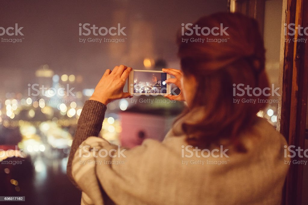 Woman taking photo of the Christmas market stock photo
