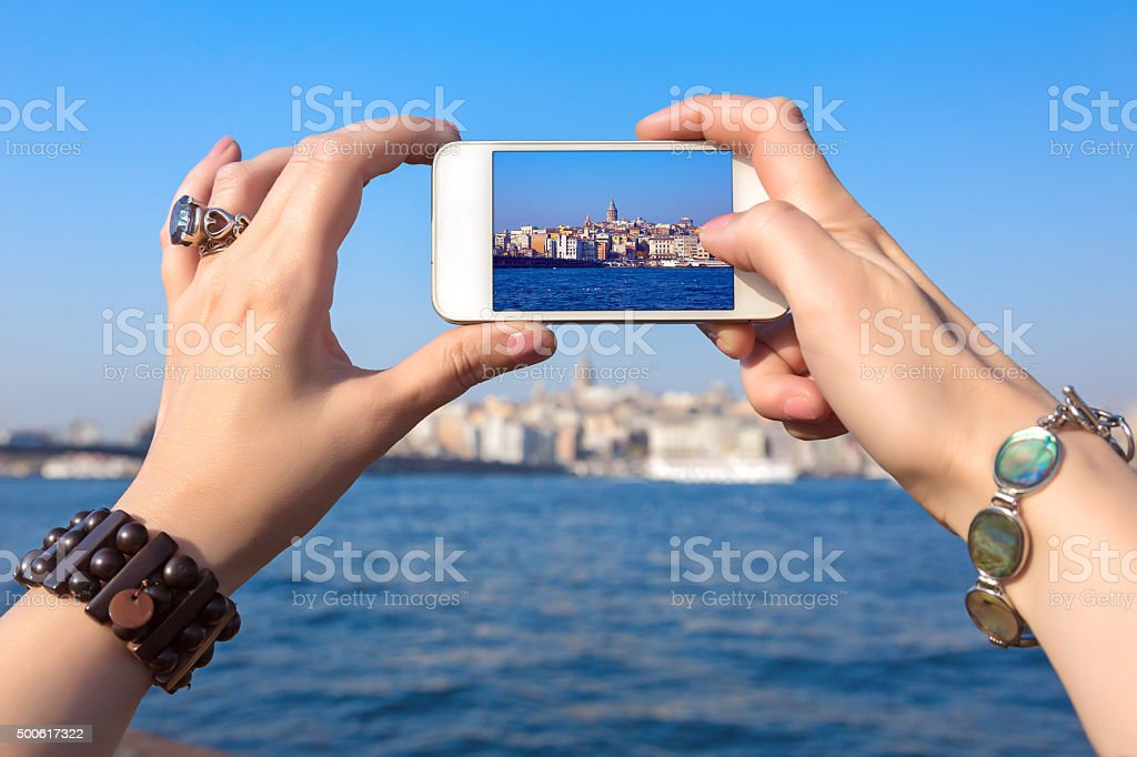 Woman taking Photo with camera phone in Istanbul city stock photo
